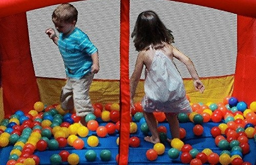 Blast Zone Magic Castle inflatable bouncer with kids in it.