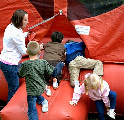 Parent supervision on bounce house.
