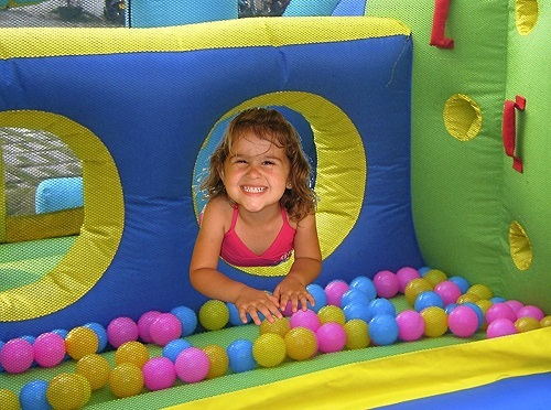 Girl playing in Combo Bounce House