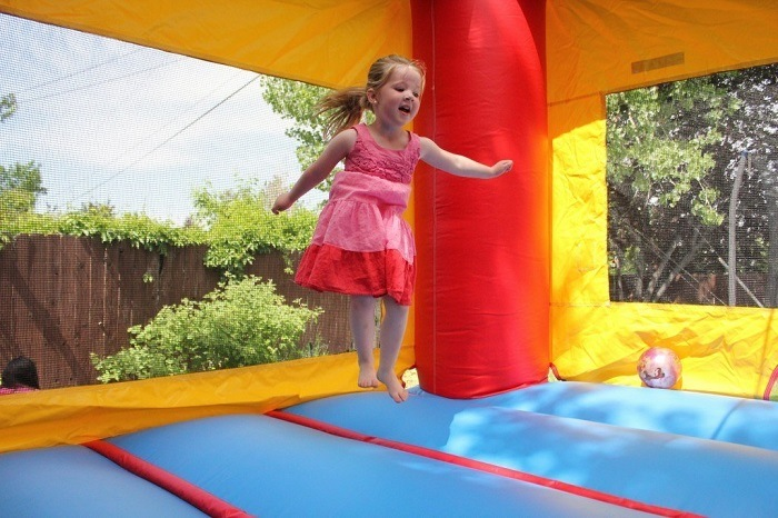Little girl playing in bounce house