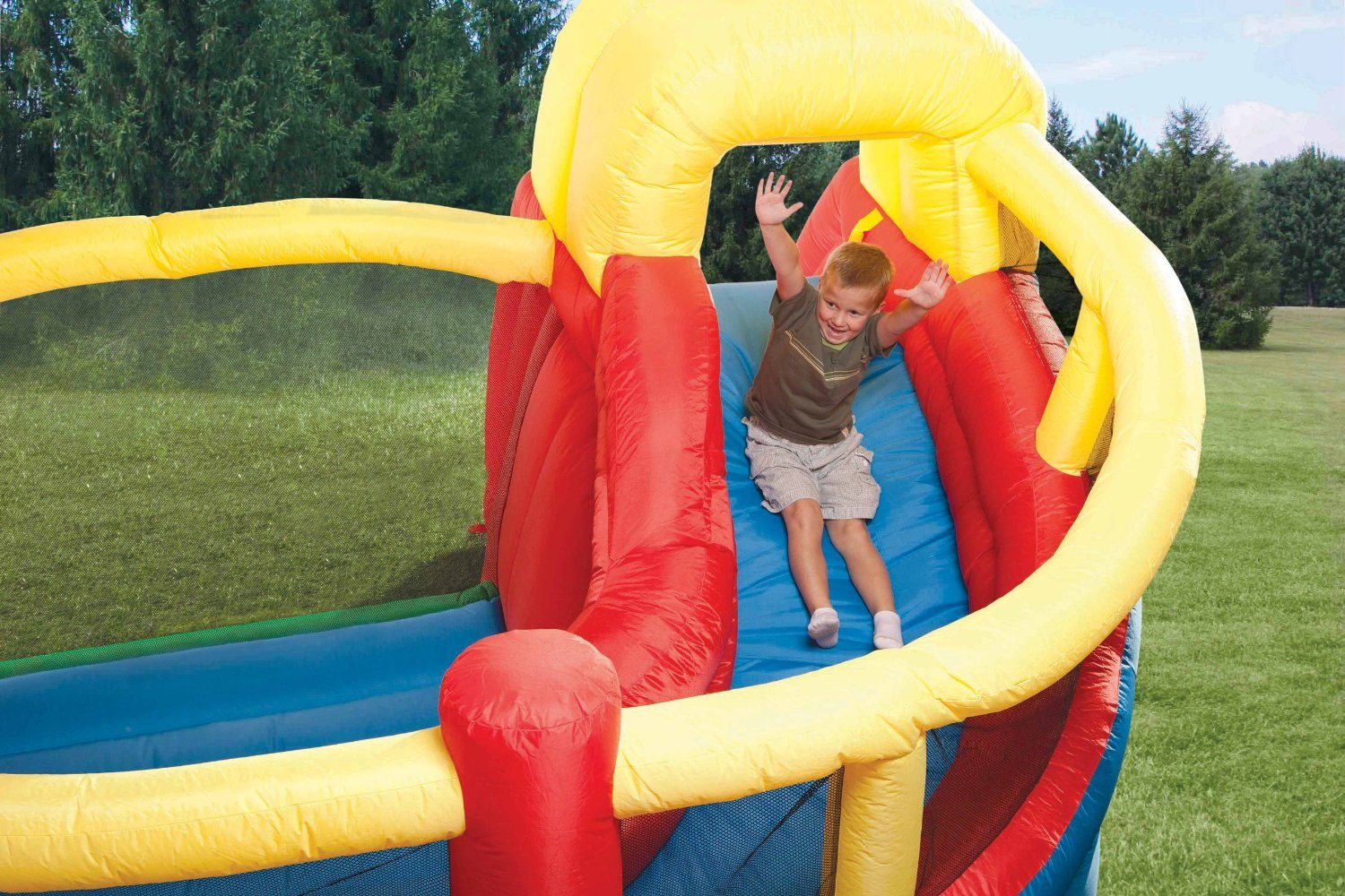 kid having fun in Little Tikes Double Slide N Fun inflatable bounce house