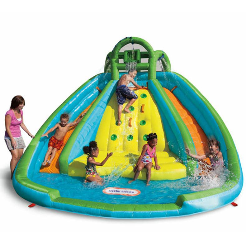 Kids sliding down a water inflatable bounce house