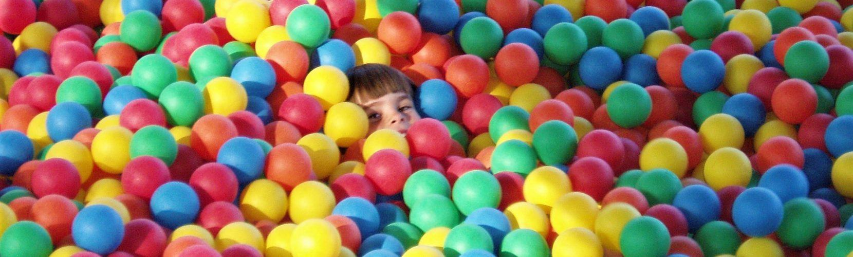kid in giant ball pit